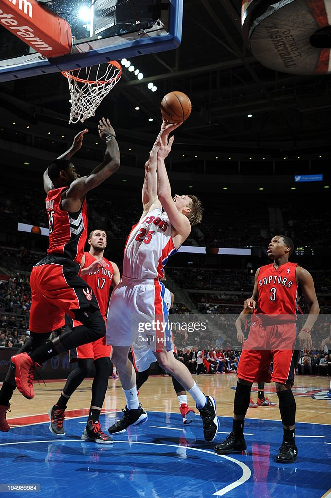 Kyle Singler #25 of the Detroit Pistons goes to the basket against Amir Johnson #15 of the Toronto Raptors during the game between the Detroit Pistons and the Toronto Raptors on March 29, 2013 at The Palace of Auburn Hills in Auburn Hills, Michigan.