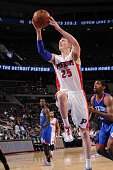 Kyle Singler of the Detroit Pistons goes to the basket against the Philadelphia 76ers on October 23 2014 at The Palace of Auburn Hills in Auburn...