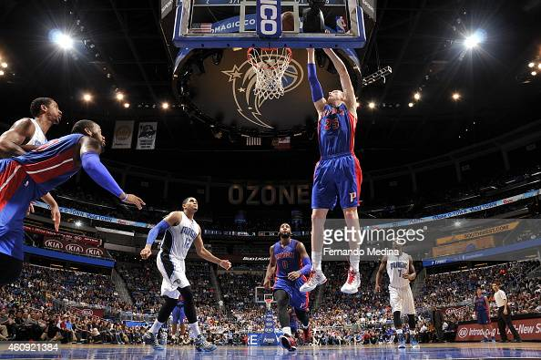 Kyle Singler of the Detroit Pistons goes to the basket against the Orlando Magic on December 30 2014 at Amway Center in Orlando Florida NOTE TO USER...