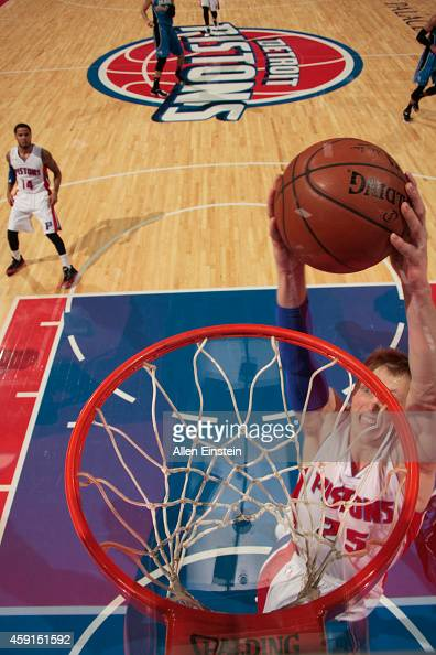 Kyle Singler of the Detroit Pistons goes up for a dunk against the Orlando Magic during the game on November 17 2014 at The Palace of Auburn Hills in...