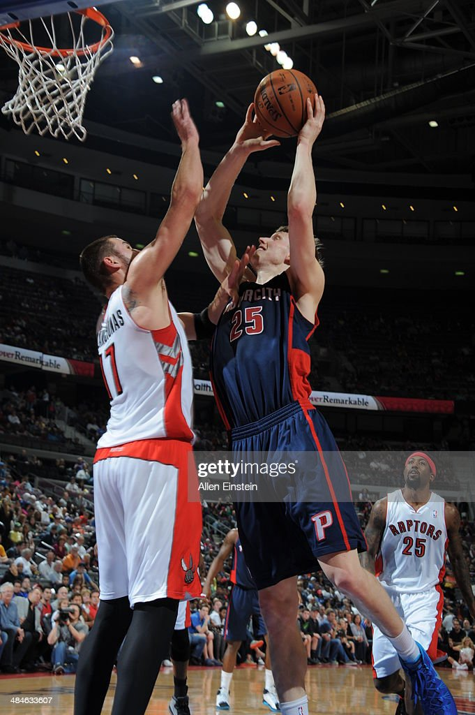 Kyle Singler #25 of the Detroit Pistons goes up for a shot against the Toronto Raptors on April 13, 2014 at The Palace of Auburn Hills in Auburn Hills, Michigan.