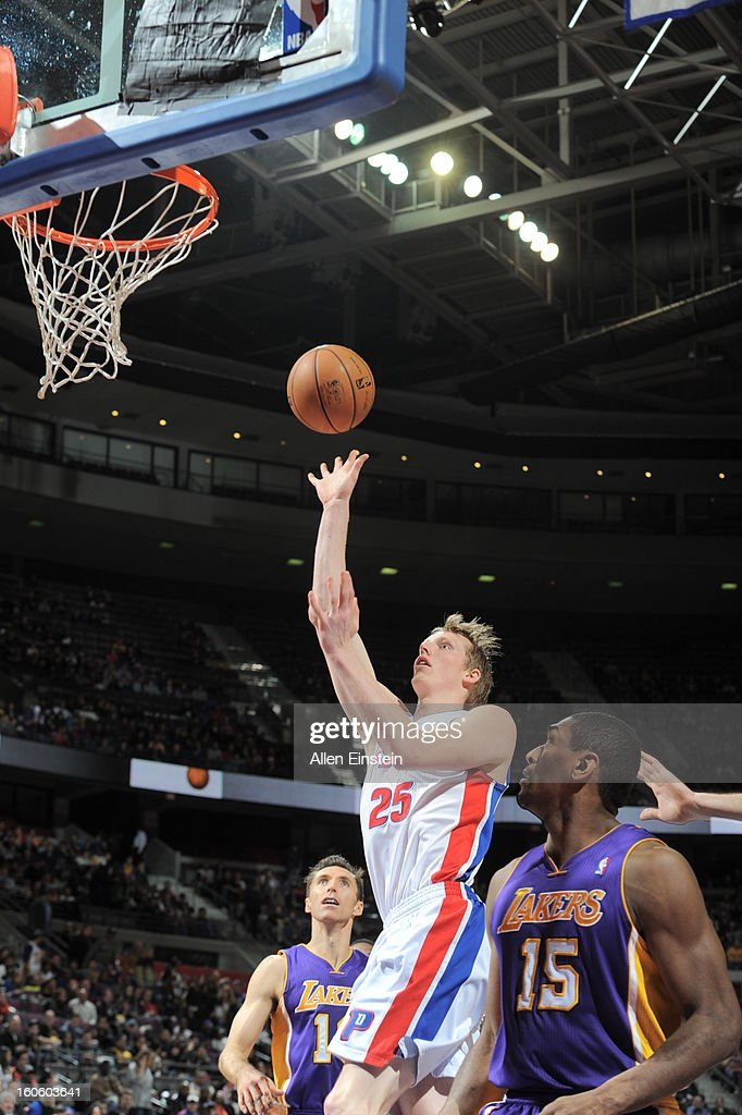 Kyle Singler #25 of the Detroit Pistons goes up for a shot againt Metta World Peace #15 of the Los Angeles Lakers during the game on February 3, 2013 at The Palace of Auburn Hills in Auburn Hills, Michigan.