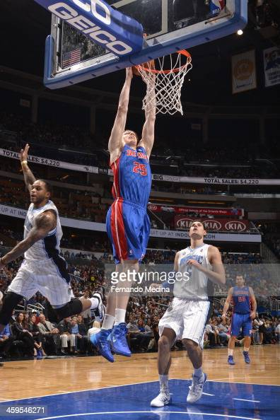 Kyle Singler of the Detroit Pistons goes up for the dunk against the Orlando Magic during the game on December 27 2013 at Amway Center in Orlando...