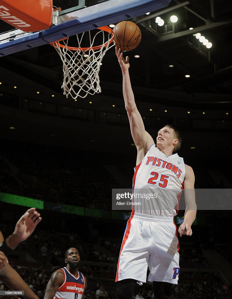 Kyle Singler #25 of the Detroit Pistons goes up for the easy basket against the Washington Wizards during the game on December 21, 2012 at The Palace of Auburn Hills in Auburn Hills, Michigan.