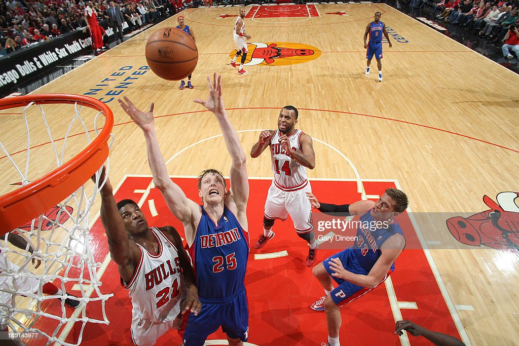 <a gi-track='captionPersonalityLinkClicked' href=/galleries/search?phrase=Kyle+Singler&family=editorial&specificpeople=4216029 ng-click='$event.stopPropagation()'>Kyle Singler</a> #25 of the Detroit Pistons grabs a rebound from <a gi-track='captionPersonalityLinkClicked' href=/galleries/search?phrase=Jimmy+Butler+-+Basketball+Player&family=editorial&specificpeople=9860567 ng-click='$event.stopPropagation()'>Jimmy Butler</a> #21 of the Chicago Bulls on March 31, 2013 at the United Center in Chicago, Illinois.