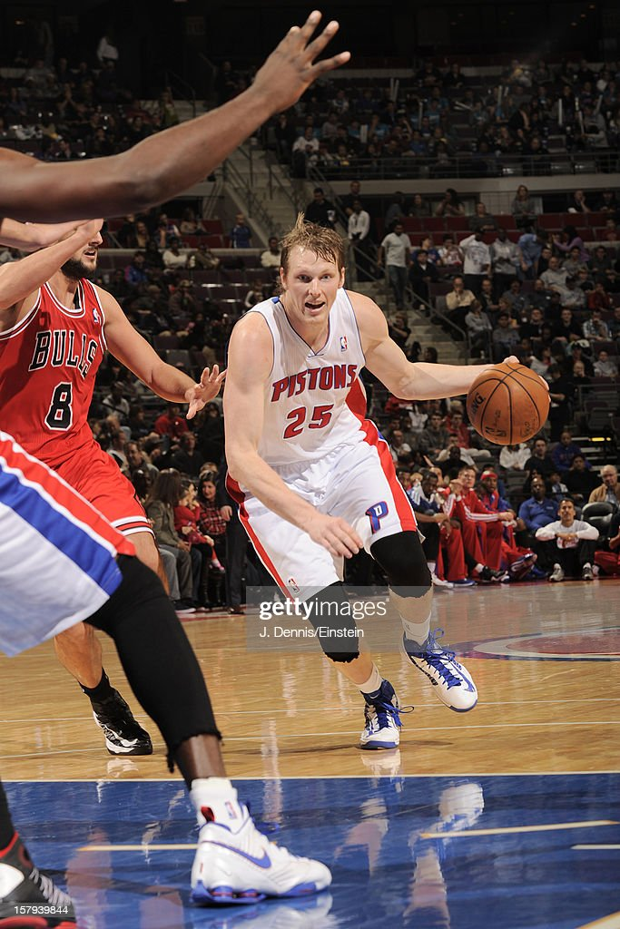 <a gi-track='captionPersonalityLinkClicked' href=/galleries/search?phrase=Kyle+Singler&family=editorial&specificpeople=4216029 ng-click='$event.stopPropagation()'>Kyle Singler</a> #25 of the Detroit Pistons handles the ball against the Chicago Bulls on December 7, 2012 at The Palace of Auburn Hills in Auburn Hills, Michigan.