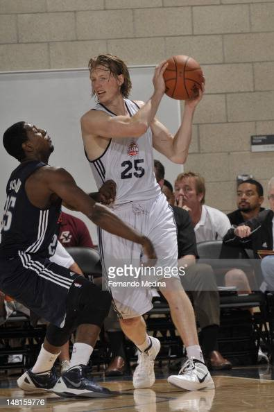 Kyle Singler of the Detroit Pistons handles the ball against the Oklahoma City Thunder during the 2012 Air Tran Airways Orlando Pro Summer League on...