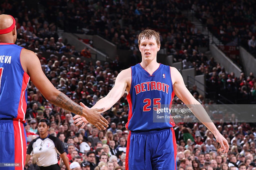 Kyle Singler #25 of the Detroit Pistons is being congratulated by Charlie Villanueva #31 of the Detroit Pistons during the game between the Detroit Pistons and the Portland Trail Blazers on March 16, 2013 at the Rose Garden Arena in Portland, Oregon.