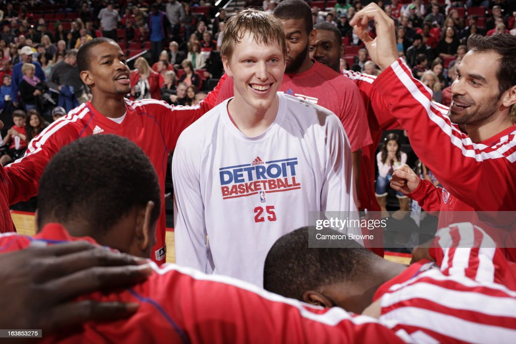 <a gi-track='captionPersonalityLinkClicked' href=/galleries/search?phrase=Kyle+Singler&family=editorial&specificpeople=4216029 ng-click='$event.stopPropagation()'>Kyle Singler</a> #25 of the Detroit Pistons is greeted by teammates during the game between the Detroit Pistons and the Portland Trail Blazers on March 16, 2013 at the Rose Garden Arena in Portland, Oregon.