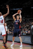 Kyle Singler of the Detroit Pistons looks to pass the ball against the Miami Heat during the game on December 8 2013 at The Palace of Auburn Hills in...