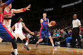 Kyle Singler of the Detroit Pistons looks to pass the ball against the Washington Wizards during the game on October 12 2014 at Verizon Center in...
