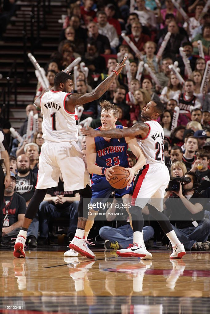 <a gi-track='captionPersonalityLinkClicked' href=/galleries/search?phrase=Kyle+Singler&family=editorial&specificpeople=4216029 ng-click='$event.stopPropagation()'>Kyle Singler</a> #25 of the Detroit Pistons passes the ball against the Portland Trail Blazers on November 11, 2013 at the Moda Center Arena in Portland, Oregon.