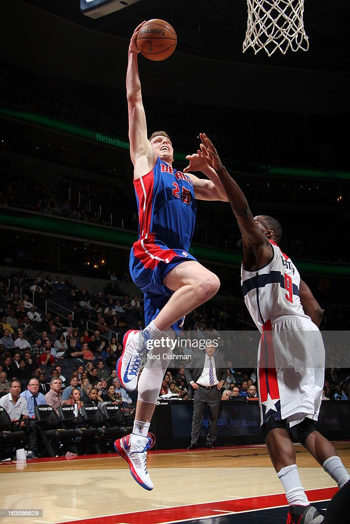<a gi-track='captionPersonalityLinkClicked' href=/galleries/search?phrase=Kyle+Singler&family=editorial&specificpeople=4216029 ng-click='$event.stopPropagation()'>Kyle Singler</a> #25 of the Detroit Pistons rises for a dunk against <a gi-track='captionPersonalityLinkClicked' href=/galleries/search?phrase=Martell+Webster&family=editorial&specificpeople=601785 ng-click='$event.stopPropagation()'>Martell Webster</a> #9 of the Washington Wizards at the Verizon Center on February 27, 2013 in Washington, DC.