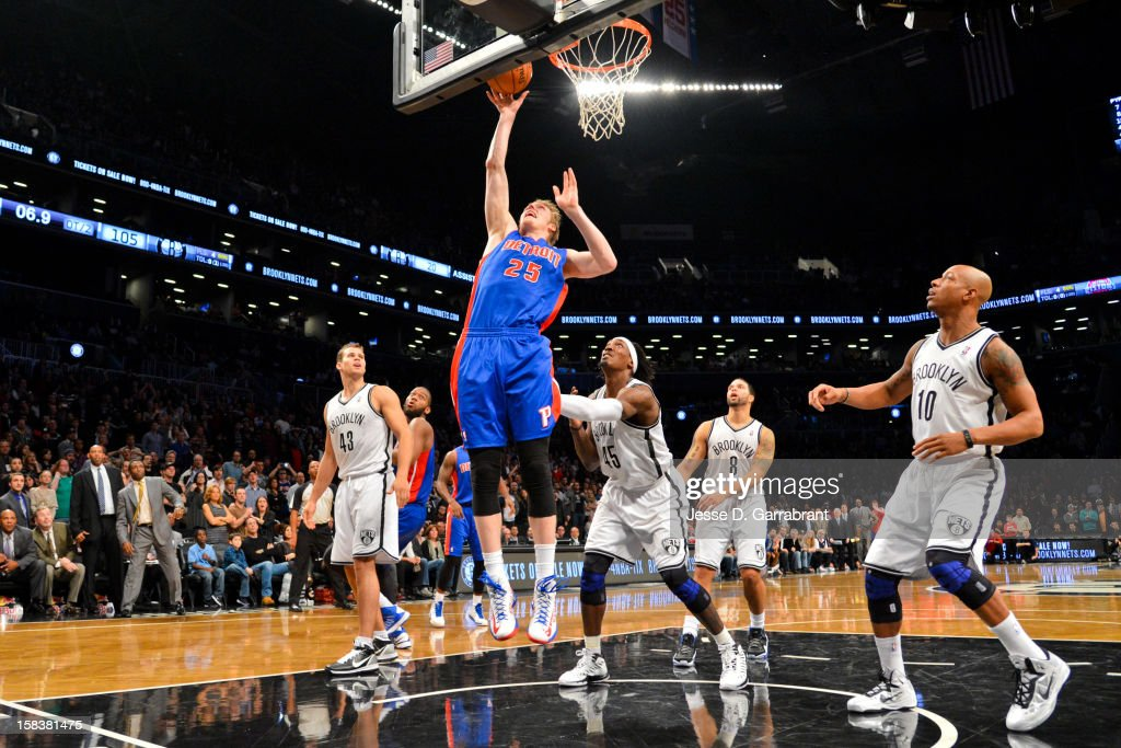 Kyle Singler #25 of the Detroit Pistons shoots a game-tying layup late in double overtime against the Brooklyn Nets at the Barclays Center on December 14, 2012 in the Brooklyn borough of New York City.