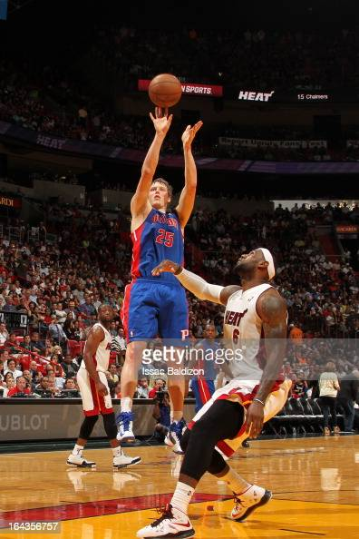 Kyle Singler of the Detroit Pistons shoots a jumper against LeBron James of the Miami Heat on March 22 2013 at American Airlines Arena in Miami...