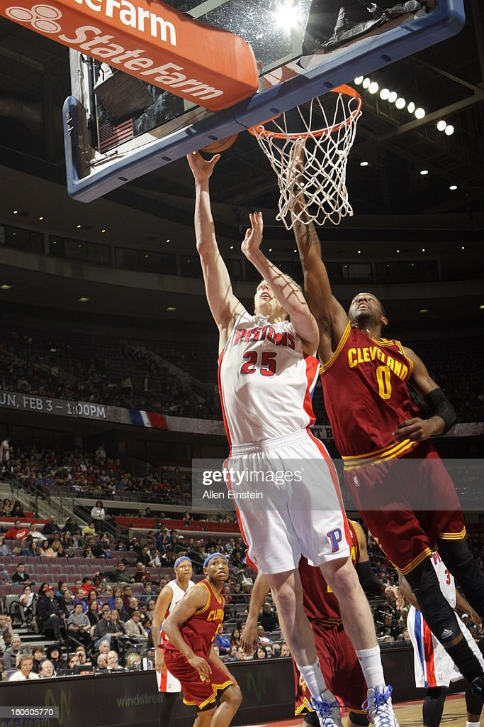 <a gi-track='captionPersonalityLinkClicked' href=/galleries/search?phrase=Kyle+Singler&family=editorial&specificpeople=4216029 ng-click='$event.stopPropagation()'>Kyle Singler</a> #25 of the Detroit Pistons shoots a layup against <a gi-track='captionPersonalityLinkClicked' href=/galleries/search?phrase=C.J.+Miles&family=editorial&specificpeople=641491 ng-click='$event.stopPropagation()'>C.J. Miles</a> #0 of the Cleveland Cavaliers on February 1, 2013 at The Palace of Auburn Hills in Auburn Hills, Michigan.
