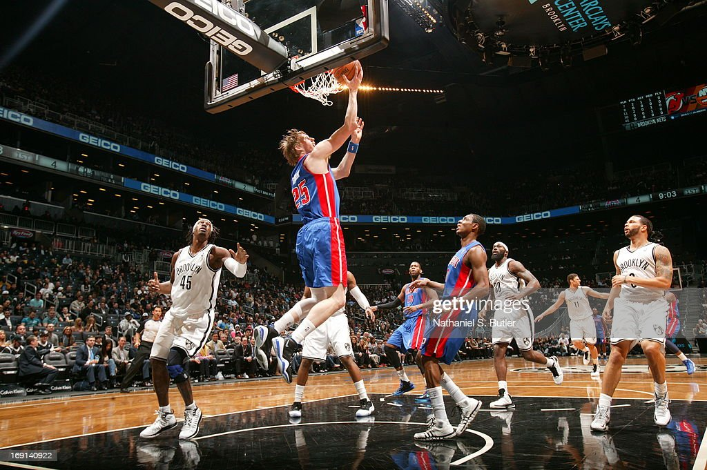 Kyle Singler #25 of the Detroit Pistons shoots a reverse layup against the Brooklyn Nets on April 17, 2013 at the Barclays Center in the Brooklyn borough of New York City.