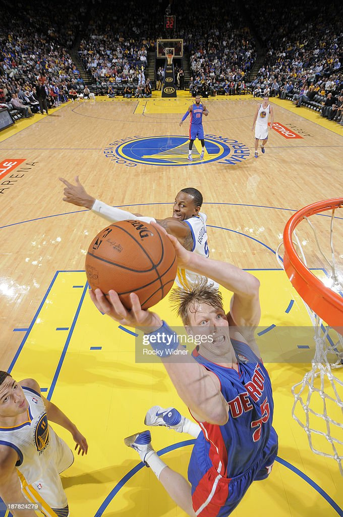 <a gi-track='captionPersonalityLinkClicked' href=/galleries/search?phrase=Kyle+Singler&family=editorial&specificpeople=4216029 ng-click='$event.stopPropagation()'>Kyle Singler</a> #25 of the Detroit Pistons shoots against <a gi-track='captionPersonalityLinkClicked' href=/galleries/search?phrase=Andre+Iguodala&family=editorial&specificpeople=201980 ng-click='$event.stopPropagation()'>Andre Iguodala</a> #9 of the Golden State Warriors on November 12, 2013 at Oracle Arena in Oakland, California.