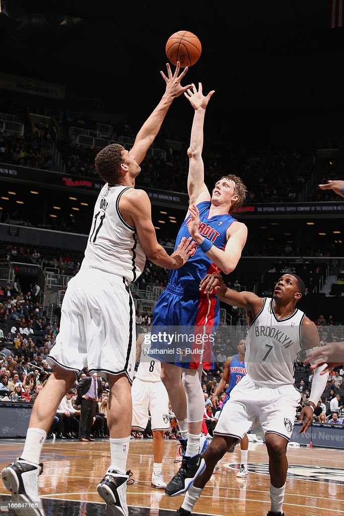 Kyle Singler #25 of the Detroit Pistons shoots against Brook Lopez #11 of the Brooklyn Nets on April 17, 2013 at the Barclays Center in the Brooklyn borough of New York City.