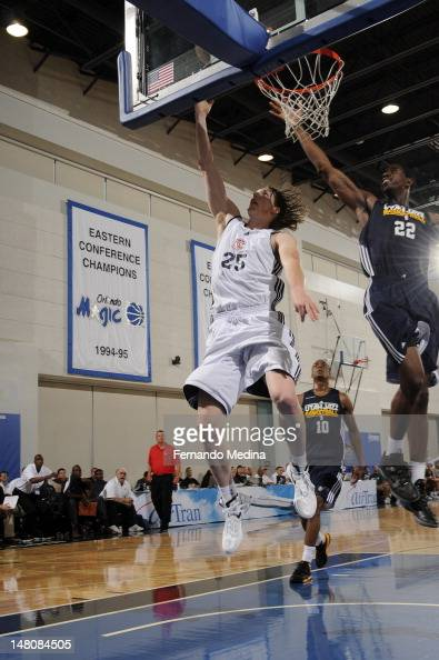 Kyle Singler of the Detroit Pistons shoots against Henry Sims of the Utah Jazz during the 2012 Air Tran Airways Orlando Pro Summer League on July 11...