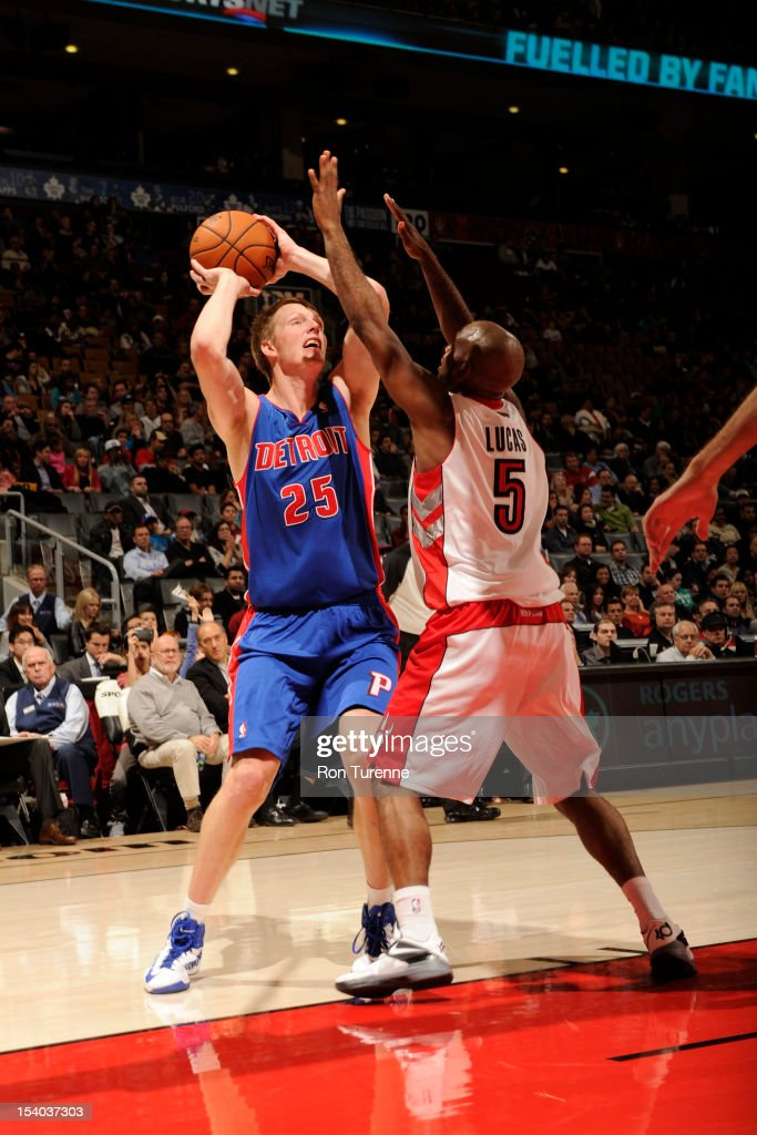 <a gi-track='captionPersonalityLinkClicked' href=/galleries/search?phrase=Kyle+Singler&family=editorial&specificpeople=4216029 ng-click='$event.stopPropagation()'>Kyle Singler</a> #25 of the Detroit Pistons shoots against John Lucas #5 of the Toronto Raptors on October 12, 2012 at the Air Canada Centre in Toronto, Ontario, Canada.
