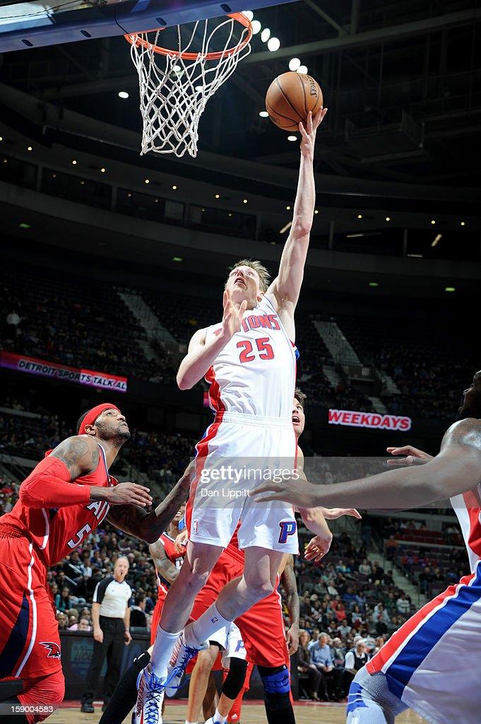 Kyle Singler #25 of the Detroit Pistons shoots against Josh Smith #5 of the Atlanta Hawks on January 4, 2013 at The Palace of Auburn Hills in Auburn Hills, Michigan.