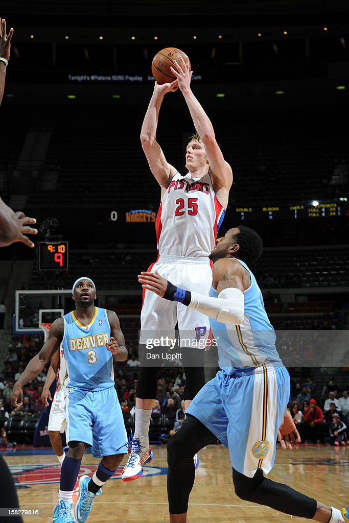 <a gi-track='captionPersonalityLinkClicked' href=/galleries/search?phrase=Kyle+Singler&family=editorial&specificpeople=4216029 ng-click='$event.stopPropagation()'>Kyle Singler</a> #25 of the Detroit Pistons shoots against the Denver Nuggets on December 11, 2012 at The Palace of Auburn Hills in Auburn Hills, Michigan.