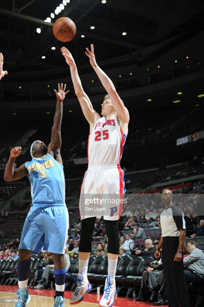 <a gi-track='captionPersonalityLinkClicked' href=/galleries/search?phrase=Kyle+Singler&family=editorial&specificpeople=4216029 ng-click='$event.stopPropagation()'>Kyle Singler</a> #25 of the Detroit Pistons shoots against <a gi-track='captionPersonalityLinkClicked' href=/galleries/search?phrase=Ty+Lawson&family=editorial&specificpeople=4024882 ng-click='$event.stopPropagation()'>Ty Lawson</a> #3 of the Denver Nuggets on December 11, 2012 at The Palace of Auburn Hills in Auburn Hills, Michigan.