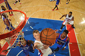 Kyle Singler of the Detroit Pistons shoots the ball against the Philadelphia 76ers during the game on January 17 2015 at The Palace of Auburn Hills...