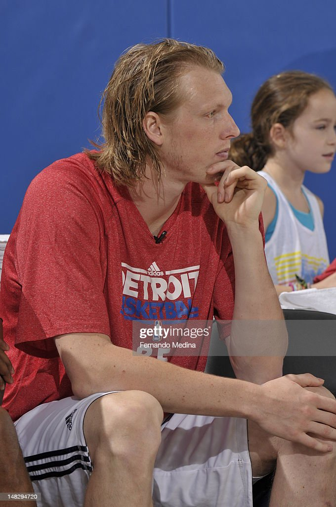 <a gi-track='captionPersonalityLinkClicked' href=/galleries/search?phrase=Kyle+Singler&family=editorial&specificpeople=4216029 ng-click='$event.stopPropagation()'>Kyle Singler</a> #25 of the Detroit Pistons sits on the bench against the Philadelphia 76ers during the 2012 Air Tran Airways Orlando Pro Summer League on July 13, 2012 at Amway Center in Orlando, Florida.