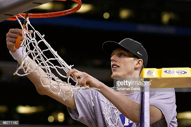 Kyle Singler of the Duke Blue Devils cuts down a piece of the net following their 6159 win against the Butler Bulldogs during the 2010 NCAA Division...