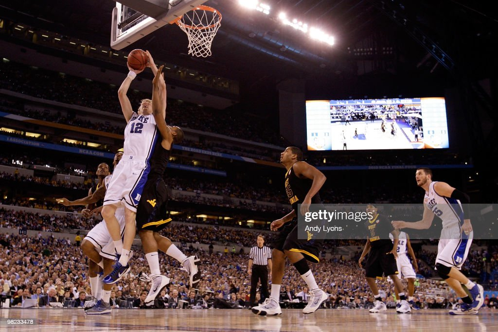 Kyle Singler of the Duke Blue Devils drives for a shot attempt in the first half against the West Virginia Mountaineers during the National Semifinal...