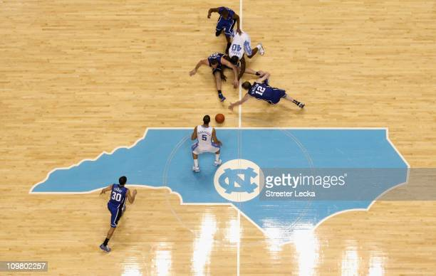 Kyle Singler of the Duke Blue Devils goes after a loose ball with Harrison Barnes of the North Carolina Tar Heels during their game at the Dean E...