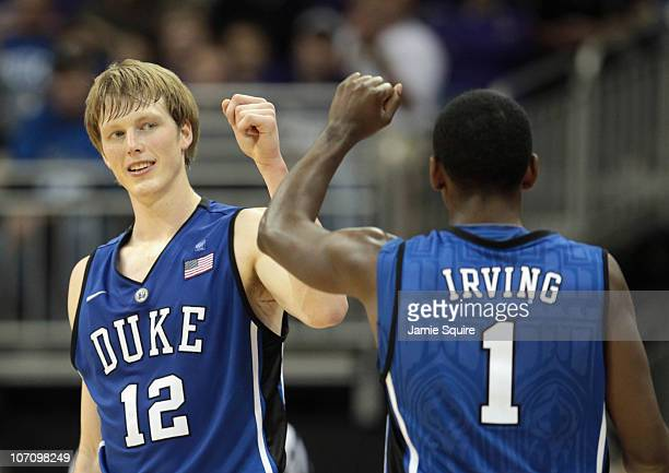 Kyle Singler of the Duke Blue Devils is congratulated by Kyrie Irving after scoring during the CBE Classic championship game on November 23 2010 at...