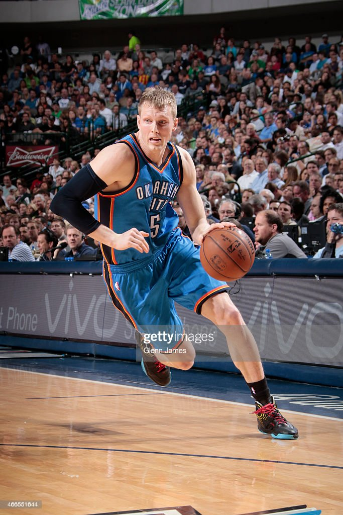Kyle Singler of the Oklahoma City Thunder drives against the Dallas Mavericks on March 16 2015 at the American Airlines Center in Dallas Texas NOTE...