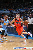 Kyle Singler of the Oklahoma City Thunder drives to the basket against the Denver Nuggets during the game on November 1 2015 at Chesapeake Energy...