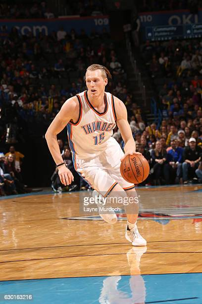 Kyle Singler of the Oklahoma City Thunder drives to the basket against the Phoenix Suns during the game on December 17 2016 at Chesapeake Energy...