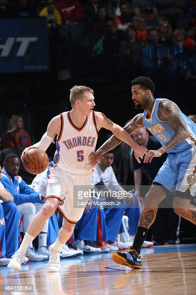 Kyle Singler of the Oklahoma City Thunder handles the ball against Wilson Chandler of the Denver Nuggets on February 22 2015 at the Chesapeake Energy...