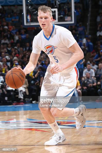 Kyle Singler of the Oklahoma City Thunder handles the ball against the Toronto Raptors on March 8 2015 at the Chesapeake Energy Arena in Oklahoma...
