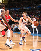 Kyle Singler of the Oklahoma City Thunder handles the ball against the Los Angeles Clippers on March 11 2015 at the Chesapeake Energy Arena in...
