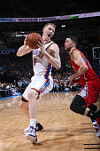 Kyle Singler of the Oklahoma City Thunder handles the ball against Austin Rivers of the Los Angeles Clippers on March 11 2015 at the Chesapeake...