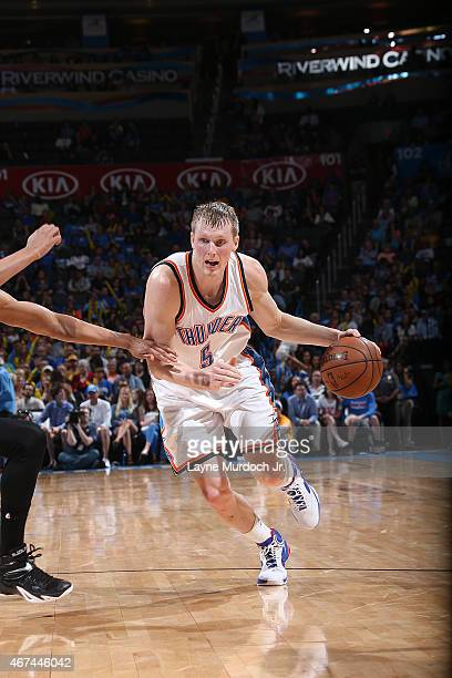 Kyle Singler of the Oklahoma City Thunder handles the ball against the Los Angeles Lakers on March 24 2015 at the Chesapeake Energy Arena in Oklahoma...