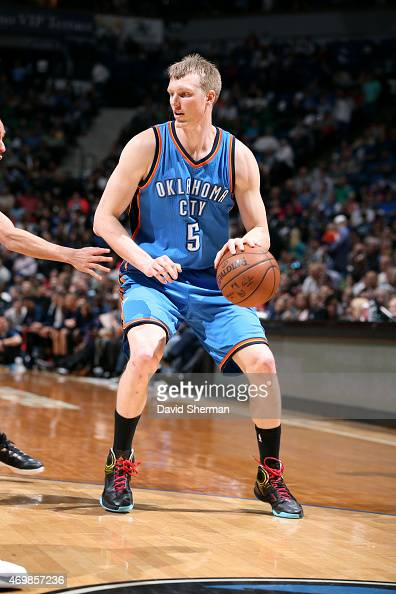 Kyle Singler of the Oklahoma City Thunder handles the ball against the Minnesota Timberwolves on April 15 2015 at Target Center in Minneapolis...