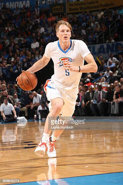 Kyle Singler of the Oklahoma City Thunder handles the ball against the New Orleans Pelicans on February 11 2016 at Chesapeake Energy Arena in...