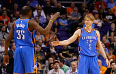 Kyle Singler of the Oklahoma City Thunder highfives Kevin Durant during the NBA game against the Phoenix Suns at Talking Stick Resort Arena on...