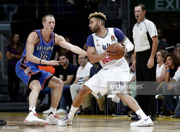 Kyle Singler of the Oklahoma City Thunder is in action against Jeffery Taylor of Real Madrid during the basketball match between Oklahoma City...
