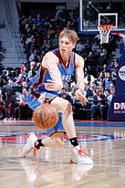 Kyle Singler of the Oklahoma City Thunder moves the ball against the Detroit Pistons during the game on March 29 2016 at The Palace of Auburn Hills...