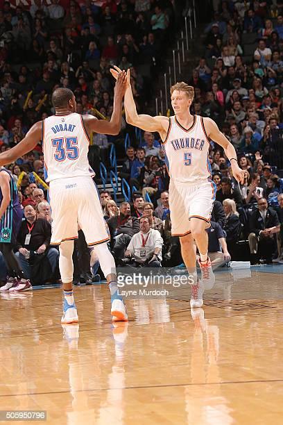 Kyle Singler of the Oklahoma City Thunder shakes hands with Kevin Durant of the Oklahoma City Thunder during the game against the Charlotte Hornets...