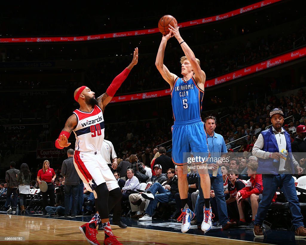 Kyle Singler of the Oklahoma City Thunder shoots against the Washington Wizards during the game on November 10 2015 at Verizon Center in Washington...