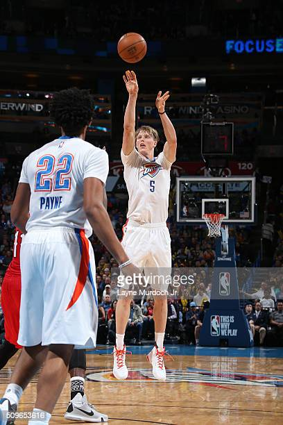 Kyle Singler of the Oklahoma City Thunder shoots the ball against the New Orleans Pelicans on February 11 2016 at the Chesapeake Energy Arena in...